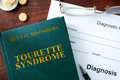 Tourette syndrome concept diagnostic form and book on a table Royalty Free Stock Photos