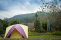 Tourism campgrounds tent camping in fresh mountain landscape Royalty Free Stock Photos