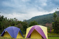 Tourism campgrounds tent camping in fresh mountain landscape Royalty Free Stock Image