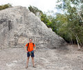 The tourist against pyramid ruins mexico archeologic zone kabah portrait in a sunny day Stock Images