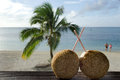 Tourist in aitutaki lagoon cook islands two coconuts with straws on bungalow balcony with couple of on honeymoon vacation the Stock Photos