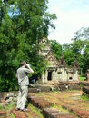 A tourist in Angkor Wat temple Stock Image