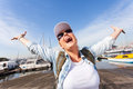Tourist arms outstretched excited by the harbor Royalty Free Stock Photos