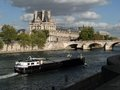 Tourist boat floats past the louvre paris sep on sep in paris france Royalty Free Stock Image