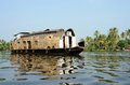 Tourist boat at kerala backwaters alleppey india it s a chain of lagoons and lakes lying parallel to arabian sea coast known as Stock Photo