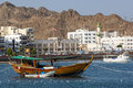A tourist boat moored in the harbour of Muscat Royalty Free Stock Photo