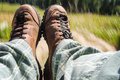 Tourist boots with mountain view on sunny day in motion Stock Photos
