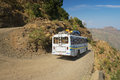 Tourist bus pass by the gravel mountain road in Axum, Ethiopia. Royalty Free Stock Photo