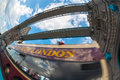 Tourist bus passing through the tower bridge in london fisheye view Royalty Free Stock Image