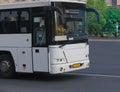 tourist bus traveling on city street Royalty Free Stock Photo