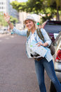 Tourist cab street pretty hailing a in the Royalty Free Stock Photo