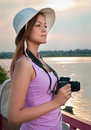 Tourist with a camera/ Royalty Free Stock Photo