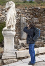 Tourist with a camera photo in ephesus turkey Royalty Free Stock Photography