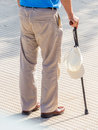 Tourist with cap and walking stick a a geshtock a for sun protection Stock Photography