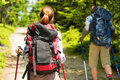 Tourist couple hiking in forest summer Royalty Free Stock Photos