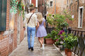 Tourist couple walking in romantic city Royalty Free Stock Photo