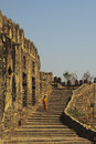 Tourist descending stairs, Golconda, Hyderabad Stock Photography