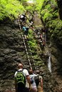 Tourists climbing iron ladders in Slovak Paradise Royalty Free Stock Photo