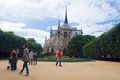 Tourist in the garden of Notre Dame, Paris Royalty Free Stock Photo