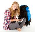 Tourist girl with backpack and map Royalty Free Stock Image