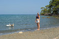 Tourist girl and geese in the water phaselis turkey Royalty Free Stock Photo