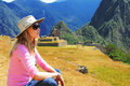 A tourist girl sitting in Machu Picchu, Peru Stock Photography