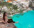 Tourist girl visiting Montenegro. Traveller sightseeing Old Venetian Castello Fortress is attraction symbol of the Montenegrin to Royalty Free Stock Photo