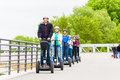 Tourist group driving Segway at sightseeing tour Royalty Free Stock Photo