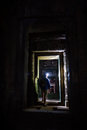 Tourist with headlamp explores ruins Angkor Wat Stock Photo