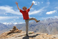 Tourist hiker hands up on mountain top Royalty Free Stock Images