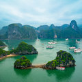 Tourist junks at ha long bay south china sea vietnam floating among limestone rocks early morning in southeast asia two images Stock Image