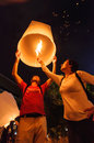 Tourist launching sky lantern chiang mai thailand november in loy krathong and yi peng festival on november chiangmai thailand Royalty Free Stock Photo