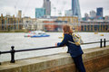 Tourist in london on the thames embankment with famous skyscrapers background Royalty Free Stock Image