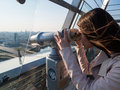 Tourist look observant binoculars telescope on panoramic view Royalty Free Stock Photo