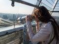 Tourist look observant binoculars telescope on panoramic view