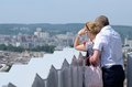 Tourist loving couple looking at modern part of lviv city ukraine lvov june unidentified in lvov on june lvov is one medieval Stock Photography