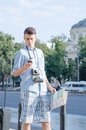 Tourist with map and mobile phone a orienting himself in the city using a his Stock Photography