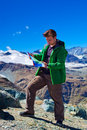 Tourist with map on mountains background Royalty Free Stock Photography