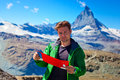 Tourist with map on mountains background Royalty Free Stock Image