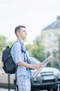 Tourist with map a orienting himself using a Royalty Free Stock Image