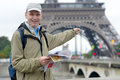 Tourist with a map in paris france Royalty Free Stock Image