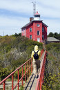 Tourist by Marquette Harbor Lighthouse Royalty Free Stock Photo