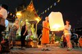 Tourist and monk float a lantern at yee peng chiang mai thailand november loy krathong festival sky together in front of buddhist Stock Photo