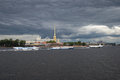 Tourist motor ships against the background of the Peter and Paul Fortress under the storm sky. Saint Petersburg