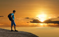 Tourist on mountain of gold sunset. Royalty Free Stock Photo