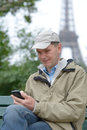 Tourist in paris france with smartphone sitting on the bench Stock Photos