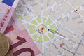 Tourist photo of map of paris and euro money Royalty Free Stock Photography