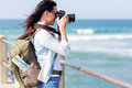 Tourist photographing beach happy young at Royalty Free Stock Images