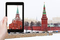 Tourist photographs Kremlin in winter snowing day Royalty Free Stock Photo