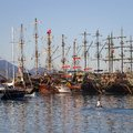 Tourist pirate sailing ships near the pier in the Mediterranean Sea. Port of Kemer, Turkey Royalty Free Stock Photo